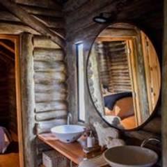 Construcciones de cabañas en tronco: Oficinas y Tiendas de estilo  por Constructora Belaver
