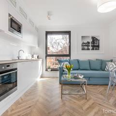 Mieszkanie na wynajem w Gdańsku: styl , w kategorii Aneks kuchenny zaprojektowany przez Tomasz Miotk Fotografia