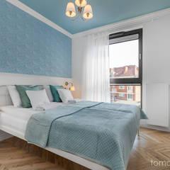 Mieszkanie na wynajem w Gdańsku: styl , w kategorii Małe sypialnie zaprojektowany przez Tomasz Miotk Fotografia,Minimalistyczny