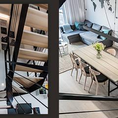 Wnętrze domu w bieli, grafice i drewnie – salon: styl , w kategorii Schody zaprojektowany przez SZARA / studio
