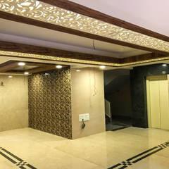 Residential Lobby:  Corridor & hallway by InkSouq Design Studio,