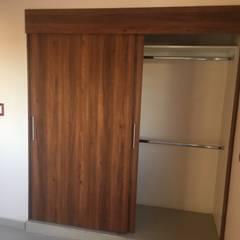 ห้องนอนขนาดเล็ก by Mitika cocinas