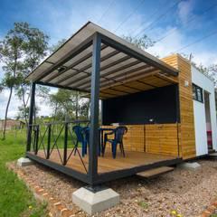 Modulo Barbecue + Baños: Casas campestres de estilo  por Camacho Estudio de Arquitectura, Rural Derivados de madera Transparente