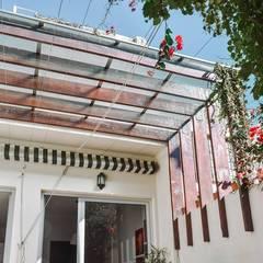 Reforma Casa NI: Jardines de estilo  por ERA - Estudio Rosarino de Arquitectura