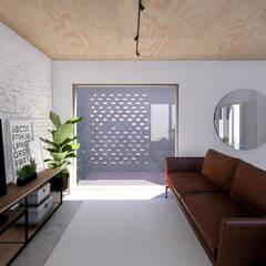 Vivienda de múltiples patios: Livings de estilo  por Arquitecto Manuel Morón