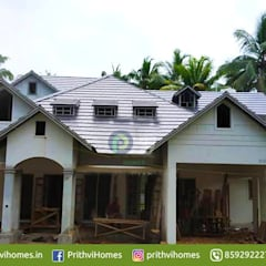 leading house builders in thrissur:  Balcony by Prithvi Homes