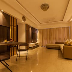 1 BHK residence.:  Living room by Sagar Shah Architects