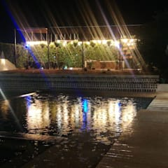 Casa unifamiliar en Girardot: Piscinas de jardín de estilo  por Parámetro Arquitectura & Ingeniería