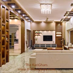 Living room designs:  Living room by The KariGhars