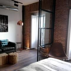 Apartamento turístico en La Latina: Salones de estilo  de GARMA+ZAMBRANO Arquitectura