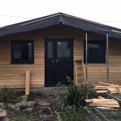 Workshop Redruth - Siberian Larch:  Wooden houses by Building With Frames