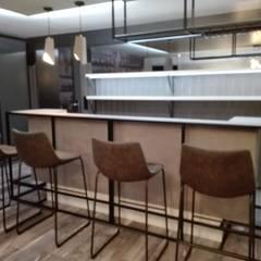 Kellerbar am Bodensee:  Weinkeller von STYLE-interior design,  Ganal + Sloma