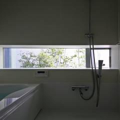 ハーフユニットの浴室: 設計事務所アーキプレイスが手掛けた浴室です。