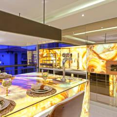 Apartamento Golden: Varandas  por Designer de Interiores e Paisagista Iara Kílaris