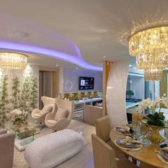 Apartamento Cavalli: Salas de estar  por Designer de Interiores e Paisagista Iara Kílaris