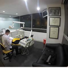 Consultorio Odontológico 127 : Clínicas de estilo  por TikTAK ARQUITECTOS