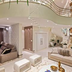 Casa Antúrio: Salas de estar  por Designer de Interiores e Paisagista Iara Kílaris