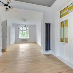 Urokliwy apartament w Sopockiej kamienicy : styl , w kategorii Korytarz, przedpokój zaprojektowany przez Pro-Plan-Foto