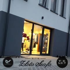 Oświetlenie salonu odzieżowego: styl , w kategorii Powierzchnie handlowe zaprojektowany przez The Light
