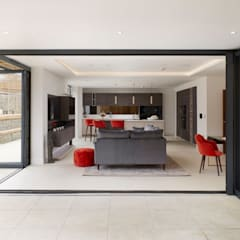 Luxurious Kitchen / TV area designed and installed in a new housing development :  Built-in kitchens by PTC Kitchens