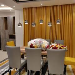 Villa #4 , Pavani Boulevard - Turn Key Project Interior :  Dining room by Enrich Interiors & Decors,Modern