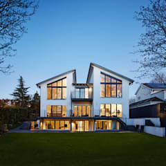 Modern Three Storey Townhouse Bennett:  Prefabricated home by Baufritz (UK) Ltd.