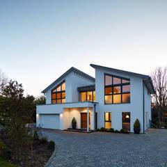 Modern Three Storey Townhouse Bennett:  Detached home by Baufritz (UK) Ltd.