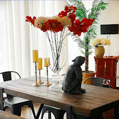 Sleek and Modern with Asian Style – Trump Tower Makati, Philippines:  Dining room by SNS Lush Designs and Home Decor Consultancy