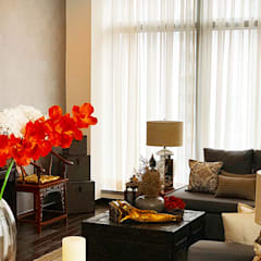 Sleek and Modern with Asian Style – Trump Tower Makati, Philippines:  Living room by SNS Lush Designs and Home Decor Consultancy