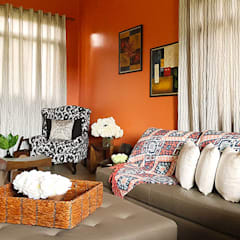 Fabulous Vacation House with a Flair – Tagaytay:  Living room by SNS Lush Designs and Home Decor Consultancy