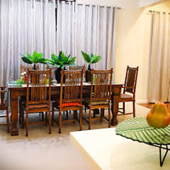 Dining room by SNS Lush Designs and Home Decor Consultancy,