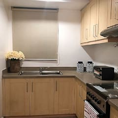 Two Bedrooms Condo at Rockwell:  Kitchen by SNS Lush Designs and Home Decor Consultancy