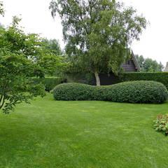 Landelijke tuin:  Tuin door De Rooy Hoveniers