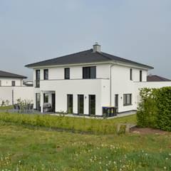 Nhà gỗ by Herrmann Massivholzhaus GmbH