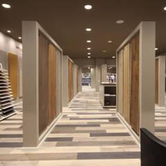 NEGOZIO ISOLMA: Negozi & Locali commerciali in stile  di JFD - Juri Favilli Design