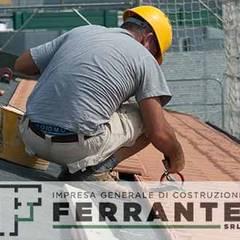 Techos a dos aguas de estilo  por Impresa Generale di Costruzioni Ferrante, Rural