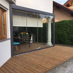 Terrasse mit Verglasung vergrößert:  Wintergarten von Schmidinger Wintergärten, Fenster & Verglasungen