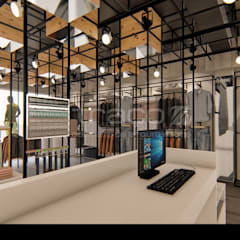 """Loja de Vestuário - """"SMK"""": Lojas e espaços comerciais  por Traço M - Arquitectura,Moderno"""