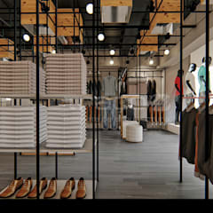 """Loja de Vestuário - """"SMK"""": Lojas e espaços comerciais  por Traço M - Arquitectura,"""