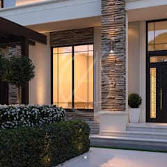 Front doors by Comelite Architecture, Structure and Interior Design