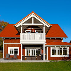 Casas de madera de estilo  por Skan-Hus Projekt GmbH