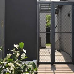 Front doors by CV Berkat Estetika, Tropical Metal