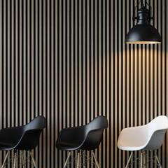Déco presenta soluzioni di rivestimento e divisione spazi per il contract.: Negozi & Locali commerciali in stile  di Déco