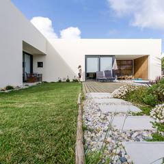 Namu House: Casas  por [i]da arquitectos,Moderno