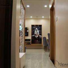 Mr. Rajiv Jambavdekar - 2BHK @ SETHIA GARCIA, Bandra, Mumbai:  Corridor & hallway by Midas Dezign,