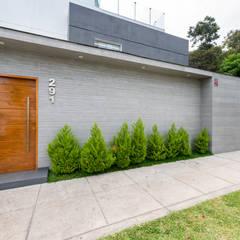 Casa del Parque: Casas unifamiliares de estilo  por ROMO ARQUITECTOS, Moderno Concreto