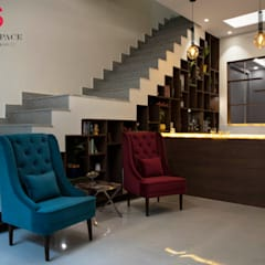 BAR AREA UNDER STAIRCASE (LANDMARK AVENUE):  Stairs by Matter Of Space Pvt. Ltd.,Modern Stone