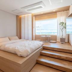 고급팬션 객실 인테리어: 도시건축디자인의  호텔,모던