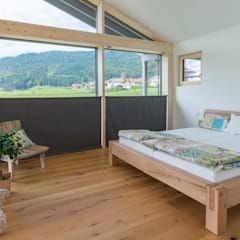 Modern style bedroom by Bau-Fritz GmbH & Co. KG Modern