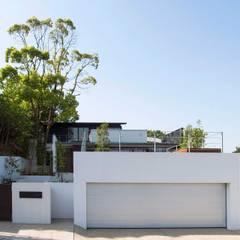 中登美ヶ丘の家 -遠景と大木を望む家-: 中澤建築設計事務所が手掛けた一戸建て住宅です。
